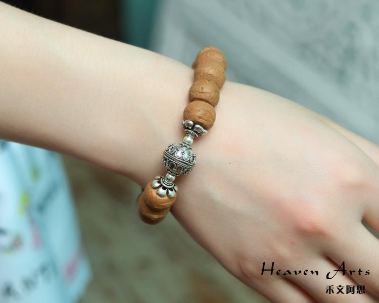 木头菩提戒指图片